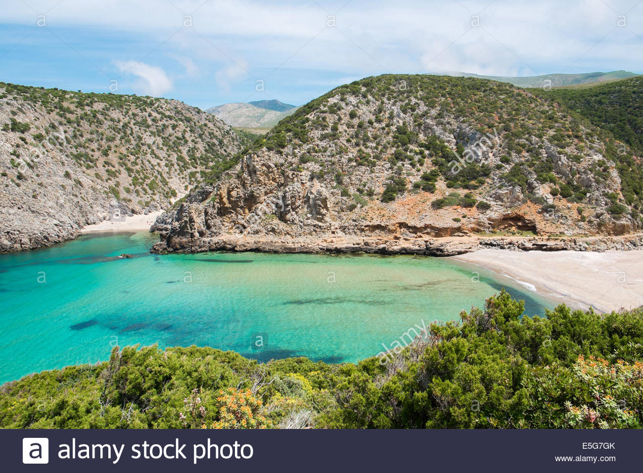 Cala Domestica Beach The Iglesiente, Cala Domestica beach and promontory, isolated and wild beach along ...