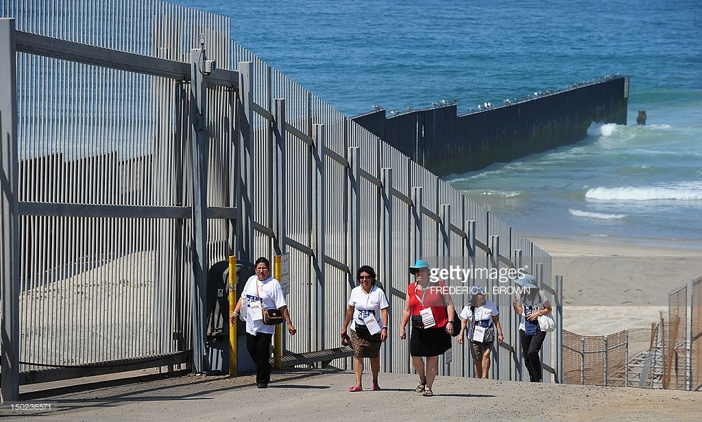 Casa de Carillo San Diego, People walk past the fence at Border Fie Pictures | Getty Images