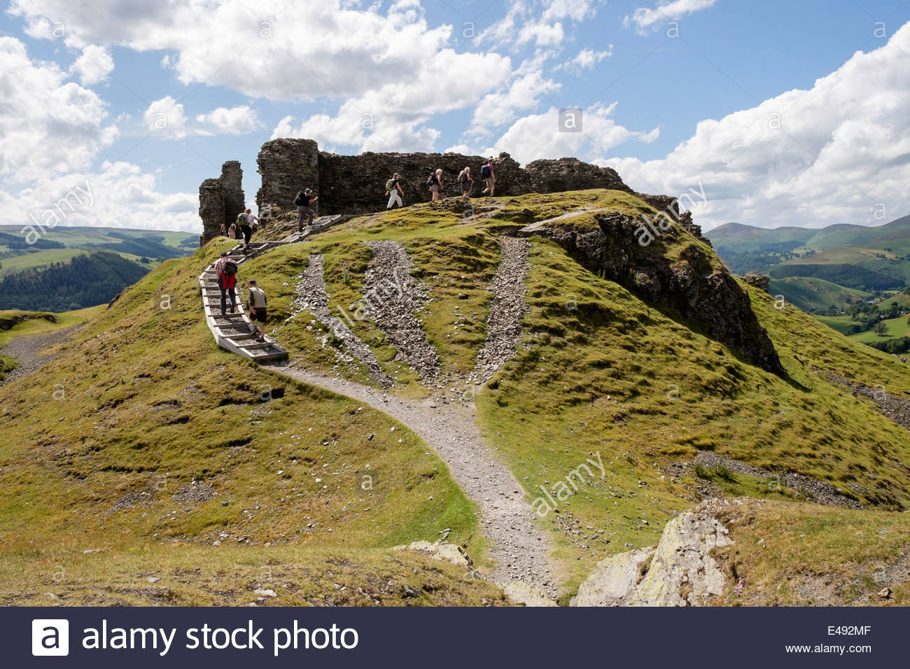 Castell Dinas Brân North Wales, Walkers on path to 13th century Castell Dinas Bran castle remains ...