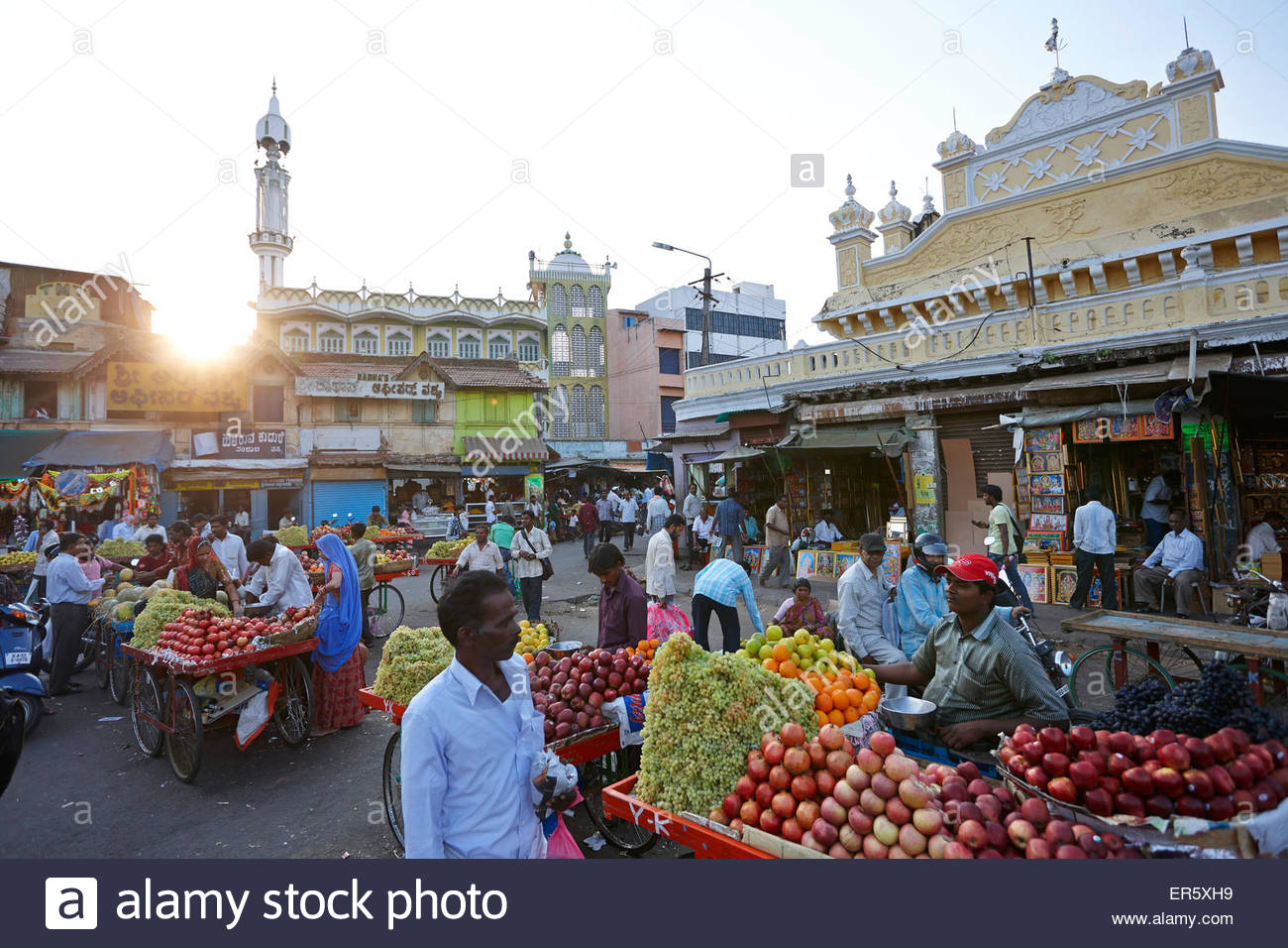 Devaraja Market Mysuru (Mysore), Mobile fruit seller at Devaraja Market, mosque in background ...