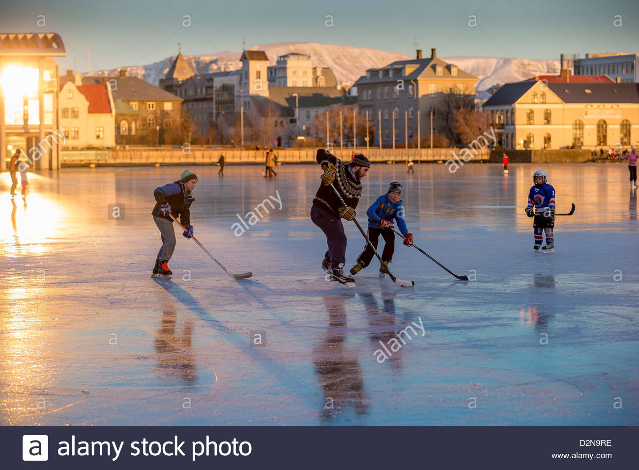 Drangey Sauðárkrókur, Playing ice hockey on the pond in Reykjavik, Iceland. Tjornin is ...