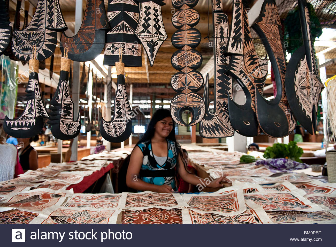Flea Market Apia, Market Trader with a Selection of Carved Samoan Weapons, Artwork ...