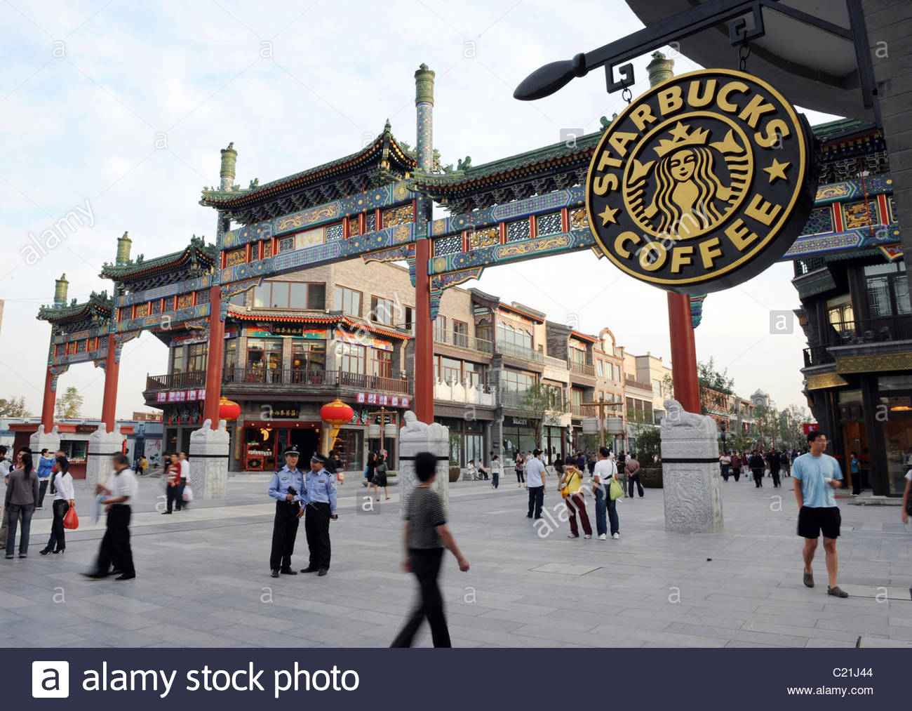 Gate Tower of the Cloud-Retaining Eaves Běijīng, A new Starbucks coffeeshop opens on Qianmen Dajie Street. Beijing ...