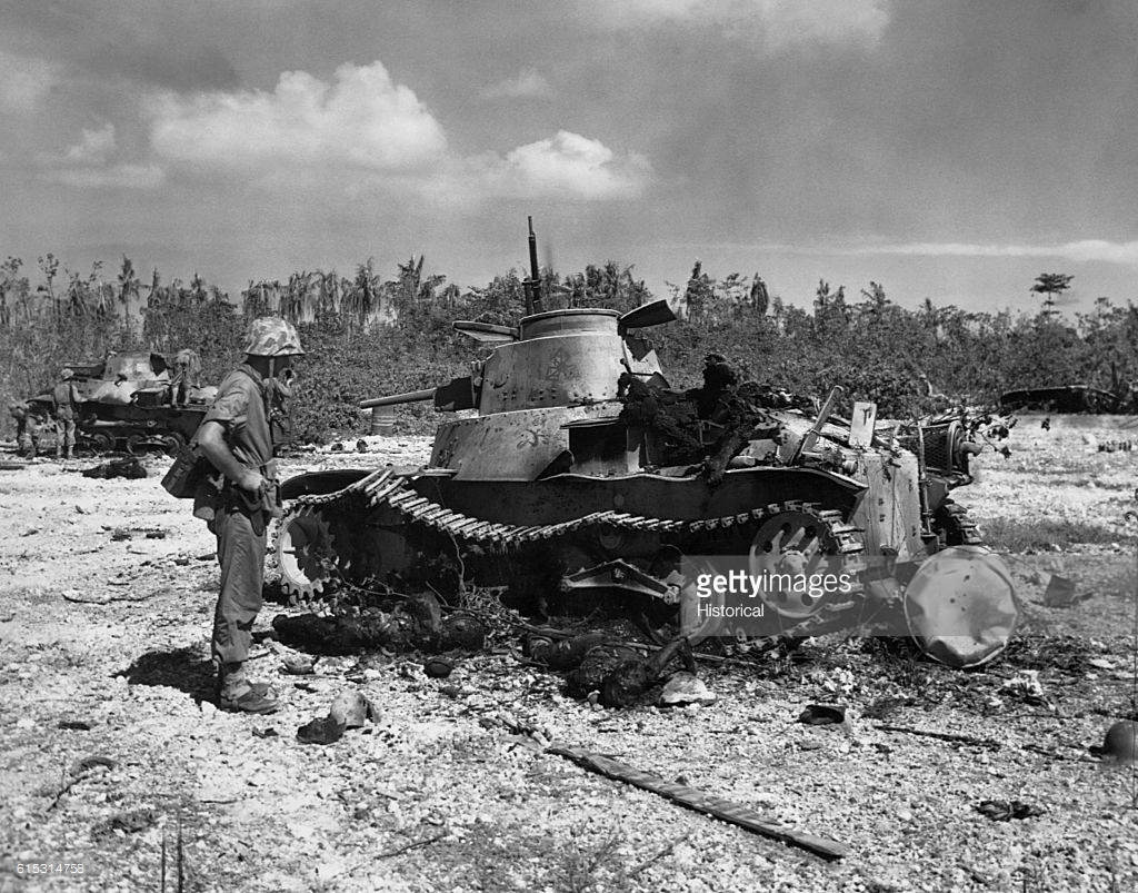 Japanese Tank Peleliu, American Soldier Inspects Damaged Japanese Tank Pictures | Getty ...