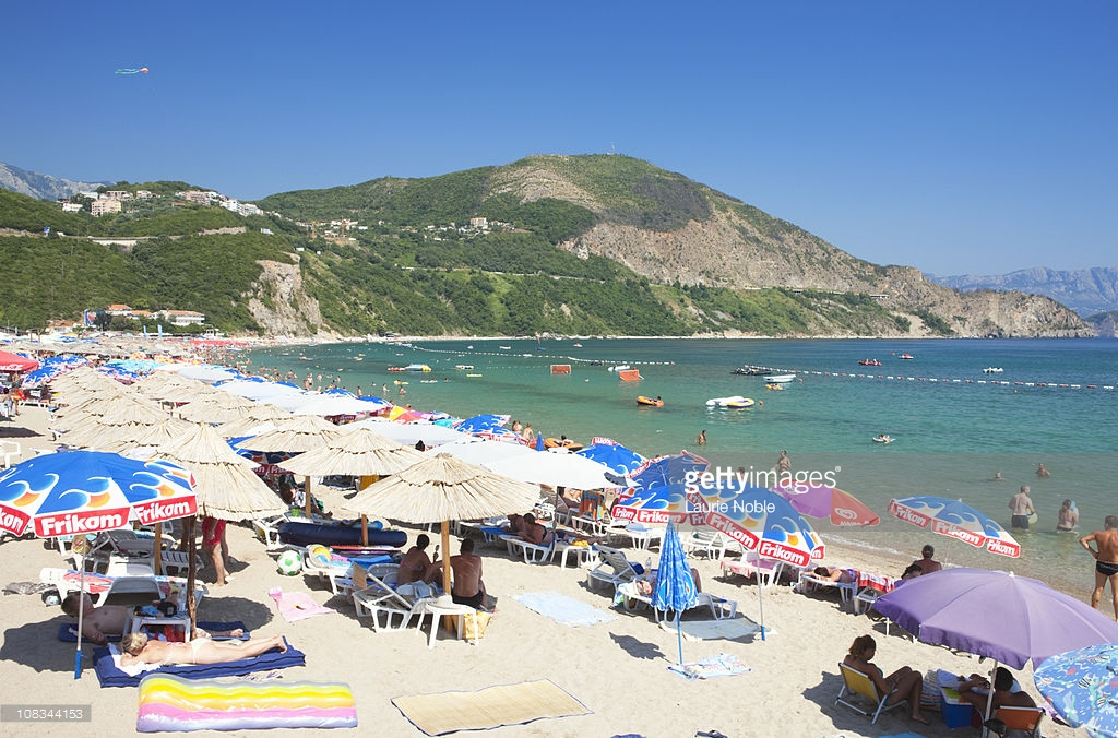 Jaz Beach Budva, Sunbathers And Parasols Jaz Beach Budva Stock Photo | Getty Images