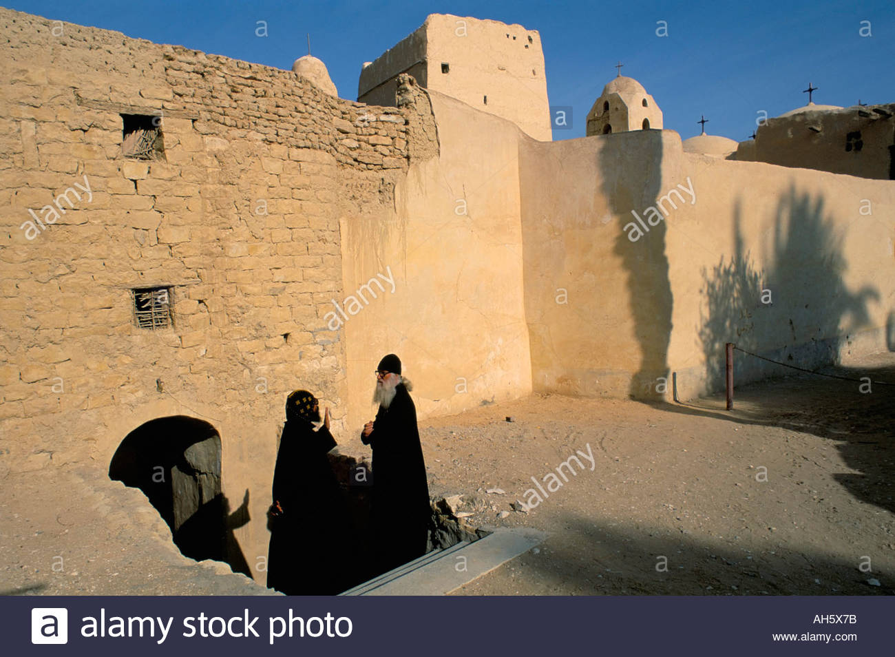 Cave of St Anthony Eastern Desert, Monk and guest by monastery walls St Antony s St Anthony s Coptic ...