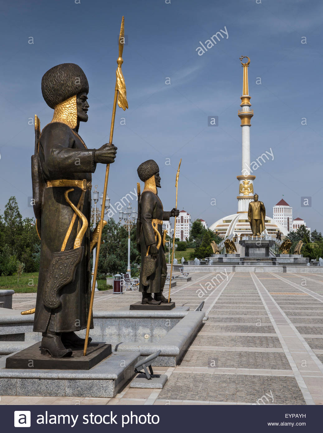 Monument to the Independence of Turkmenistan Ashgabat, Turkmen statues in front of the Independence Monument in Ashgabat ...