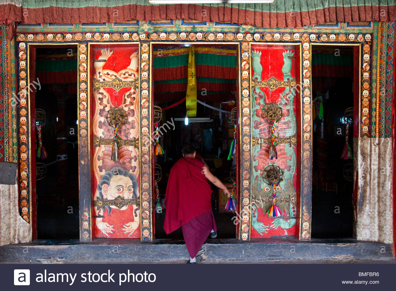 Museum of Antique Currency Beijing, Monk entering Nechung Monastery in Lhasa, Tibet Stock Photo ...