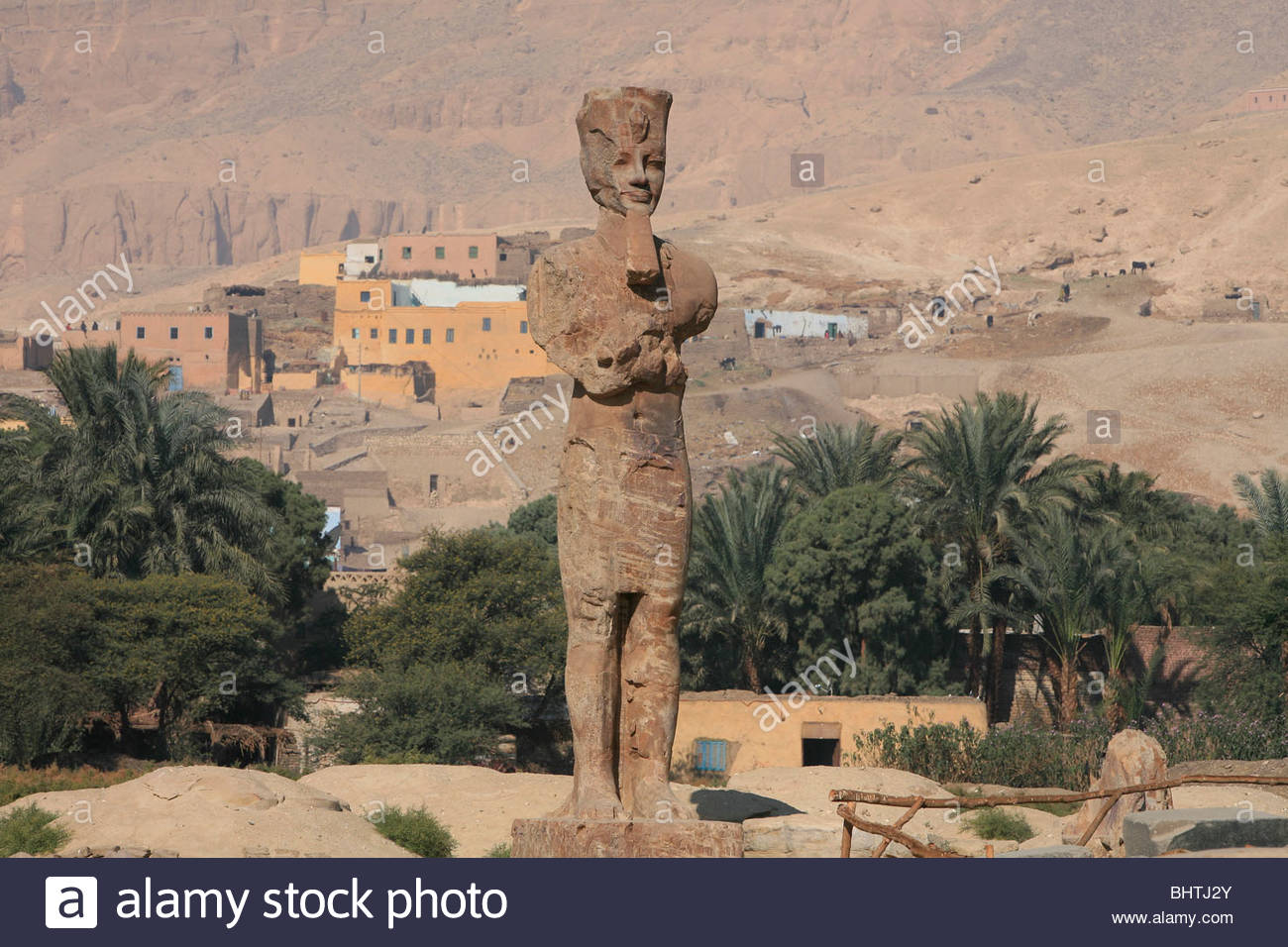 Palace of Amenhotep III Luxor, Colossal quartzite statue of Amenhotep III at his Mortuary Temple ...