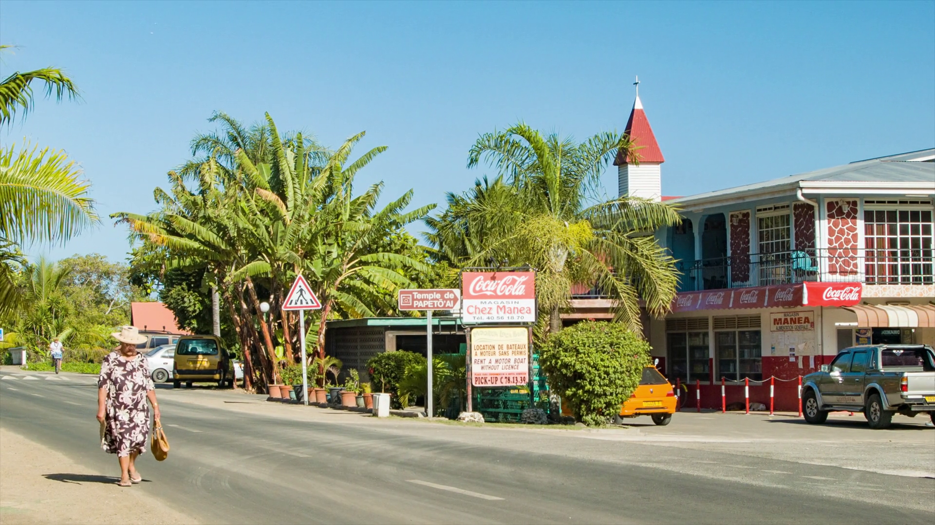 Papetoai Temple Moorea, Papetoai Town Center with Main Road Passing Local Shops and People ...