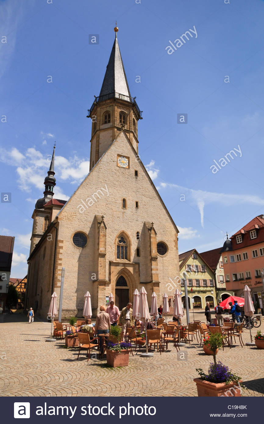 St. Georg's Church The Romantic Road, Weikersheim, Baden-Wurttemberg, Germany. Outdoor cafe by St ...