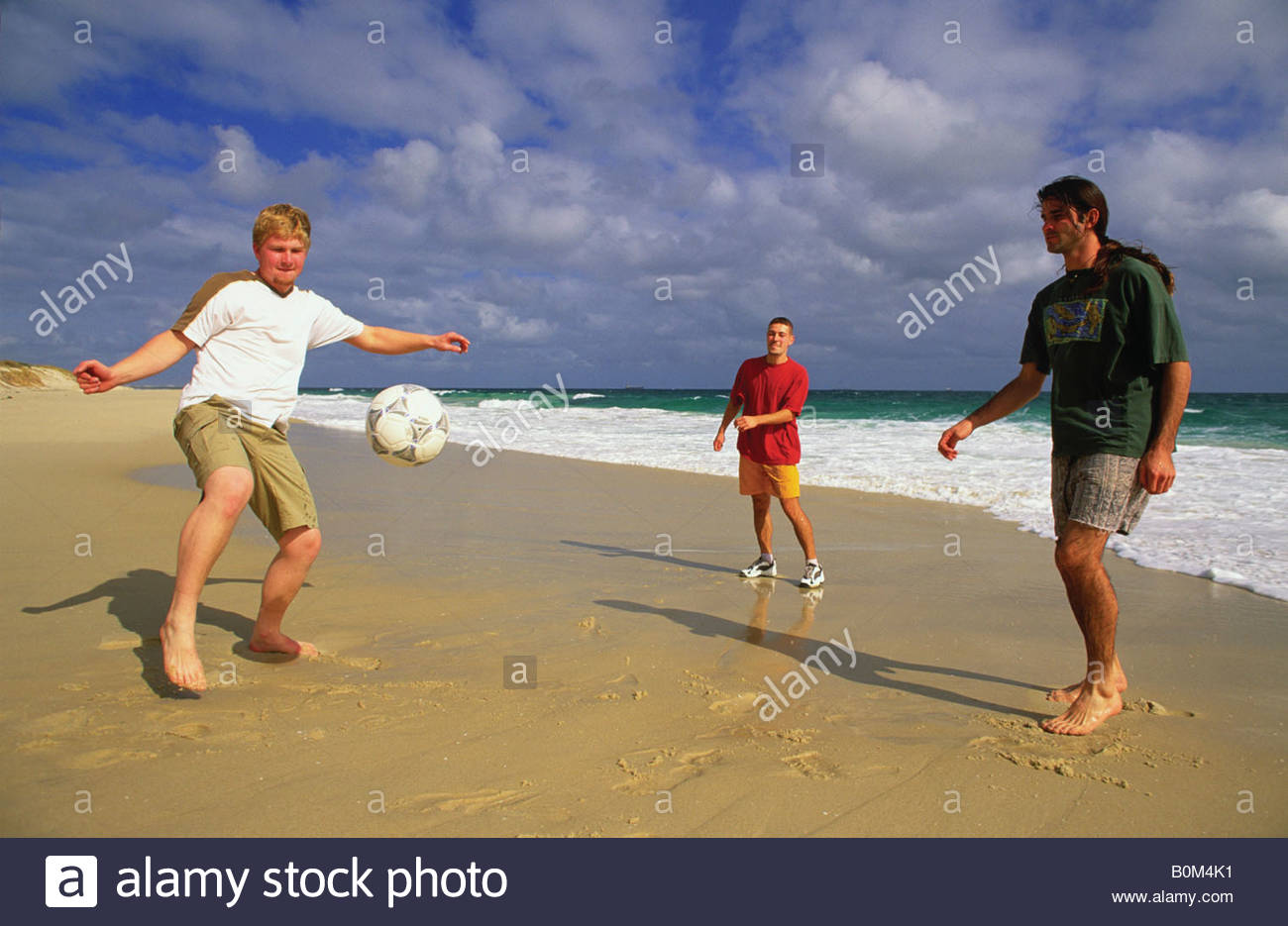 Swanbourne Beach Perth, Young men play soccer on Swanbourne Beach, Perth, Western ...
