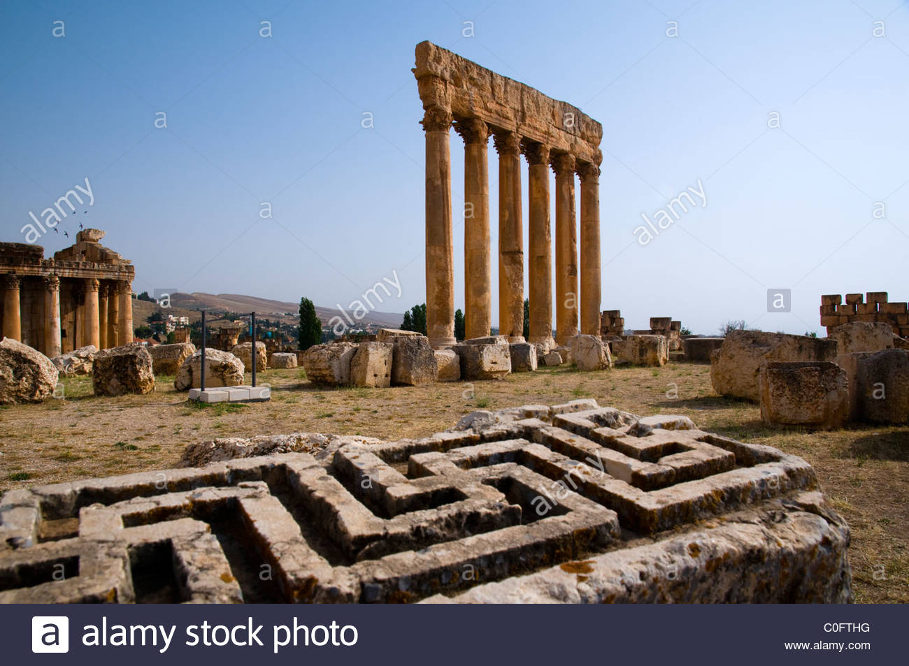 Temple of Jupiter Baalbek, Swastika cross carved in a stone and the Temple of Jupiter Stock ...