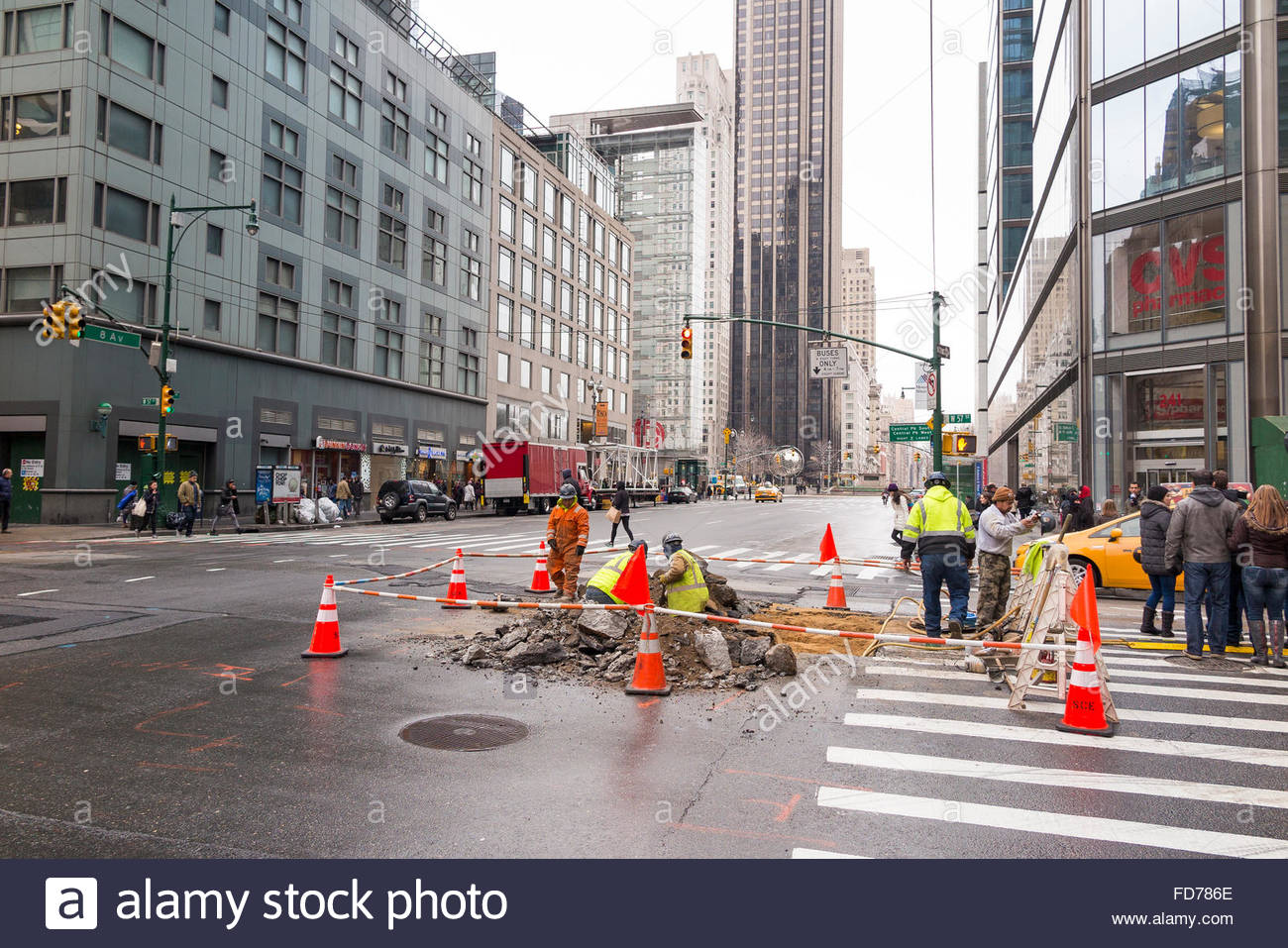 The Museum of Modern Art (MoMA) New York City, Public workers digging a hole on the street of New York City to ...