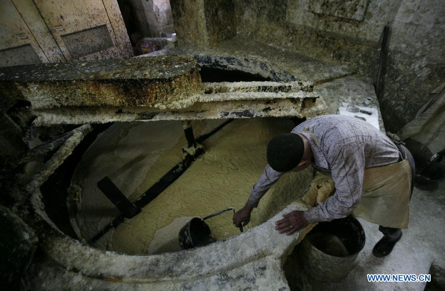 Touqan Soap Factory Nablus, A Palestinian worker lines up soap pieces at the Touqan factory in ...