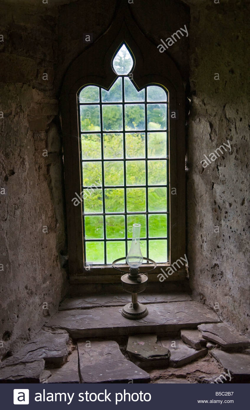 Tretower Court South Wales, Window and oil lamp in Tretower Court Powys South Wales UK a ...