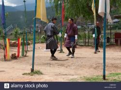 Archery Ground Paro | 2 men in traditional gho performing victory dance. paro archery ...