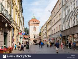 Centre of Glass Heritage Krosno   St. Florian's Gate and street scene with people and shops in Ulica ...