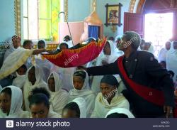 Holy Saviour Catholic Cathedral Adigrat | Ethiopia - offerings in an umbrella during palm sunday mass in the ...
