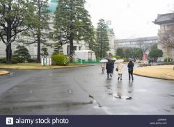 JCII Camera Museum Tokyo | People holding umbrellas walking to the Heiseikan building on the ...