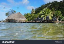 Lake Fauna Nui Huahine | Royalty-free Marae and Fare Potee on the shore of… #378444364 ...