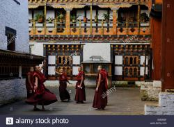 Mongar Dzong Mongar | Group of young monks practicing a religious dance in the courtyard ...