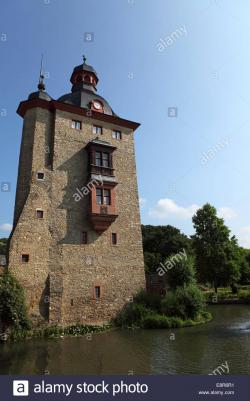 Schloss Vollrads The Rhineland | The medieval stone tower at the Schloss Vollrads wine estate in ...