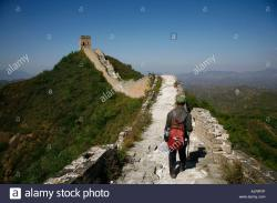 Southeast Corner Watchtower & Red Gate Gallery Běijīng | Man walking on the Great Wall near Simatai Beijing China Stock ...