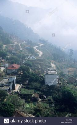 Tam Dao Hill Station Hanoi   Clouds sweep in over Tam Dao hill station north of Hanoi Stock ...