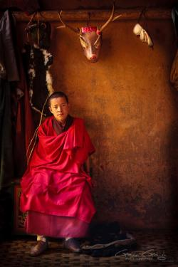 Thangbi Goemba Chokhor Valley | A Buddhist monk sitting in the dressing room beneath traditional ...