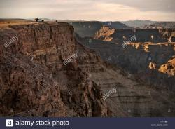 The Edge Fish River Canyon | 4x4 vehicle parked on the edge of the Fish River Canyon, offroad ...