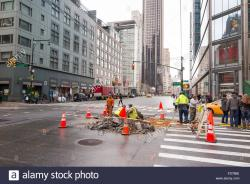 The Museum of Modern Art (MoMA) New York City | Public workers digging a hole on the street of New York City to ...