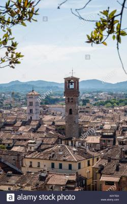 Torre delle Ore Tuscany | View to the clock tower Torre delle Ore and the church of San ...