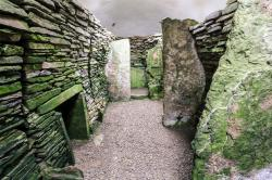 Unstan Chambered Tomb Orkney and Shetland Islands | The Unstan Cairn in Someone's Backyard - American Expeditioners