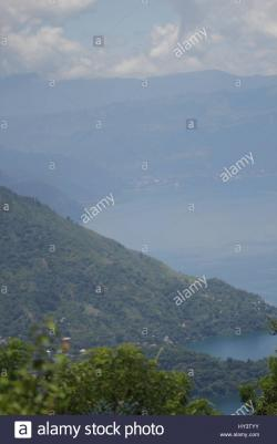 Volcanic Craters Southwest Highlands | Lake Atitlán is a body of water in a massive volcanic crater in ...