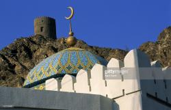 Watchtower Muscat | A Mosque With An Historical Watchtower Muscat Oman Stock Photo ...