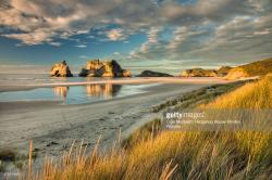 Wharariki Beach Collingwood & Around | Evening Light On Sand Dunes Archway Islands In The Distance ...